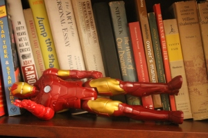Iron Man takes a siesta on my bookshelf.